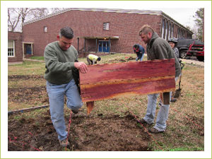 The team from of Landscape Solutions in Nashville help build and transplant the garden beds.